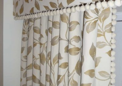 Upholstered pelmet and pleated curtain with pom-pom trimming handmade in Wymondham Norwich