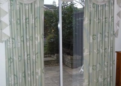 Swags and tails over pleated curtains handmade in Wymondham Norwich