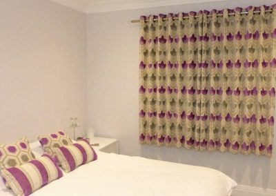 Eyelet headed curtains and coordinating cushions handmade in Wymondham Norwich