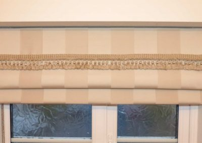 Roman blind with trimming on attached valance