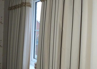 Pencil pleat heading with trimming on attached valance handmade in Wymondham Norwich