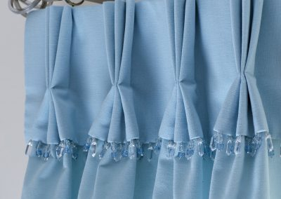 Triple pleat heading with trimming on attached valance handmade in Wymondham Norwich